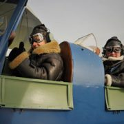 2 tiger moth pilots in cockpit